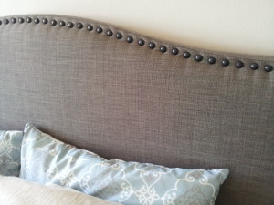 Grey linen headboard, with nail head border; classic, timeless